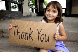 child-holding-thank-you_sign